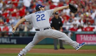 FILE - In this Oct. 7, 2016, file photo, Los Angeles Dodgers starting pitcher Clayton Kershaw delivers during the first inning in Game 1 of baseball's National League Division Series against the Washington Nationals at Nationals Park, in Washington.  The Dodgers will bring back Game 1 winner Clayton Kershaw on short rest Tuesday to face the Washington Nationals in a critical Game 4 of the National League Division Series. (AP Photo/Pablo Martinez Monsivais, File)