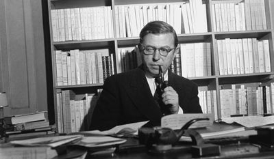 """FILE - In this Nov. 28, 1948 file photo, French author and philosopher Jean-Paul Sartre sitting in his study in Paris. The Swedish Academy awarded the Nobel Prize in Literature in 1964 to Sartre """"for his work which, rich in ideas and filled with the spirit of freedom and the quest for truth, has exerted a far-reaching influence on our age."""" However, Sartre, who was central to the rise of existential thought in the 20th century through such works as 1943's """"Being and Nothingness,""""declined the prize on the grounds that he had consistently refused all official honors. This year's winner is due to be announced on Thursday, Oct. 13, 2016. (AP Photo, File)"""