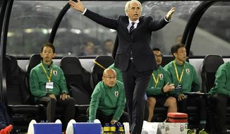 Japan manager Vahid Halilhodzic gestures during his team's World Cup qualifying match against Australia in Melbourne, Australia, Tuesday, Oct. 11, 2016. (AP Photo/Andy Brownbill)