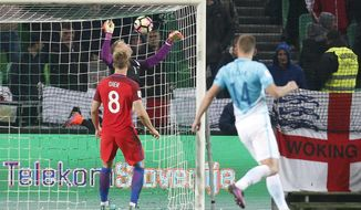 England goalkeeper Joe Hart, second left, makes a save during the World Cup Group F qualifying soccer match between Slovenia and England, at Stozice stadium in Ljubljana, Slovenia, Tuesday, Oct. 11, 2016. (AP Photo/Darko Bandic)