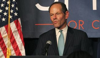 FILE - In this Sept. 10, 2013, file photo, former New York Gov. Eliot Spitzer delivers his concession speech at his election night party after losing the Democratic primary race for New York City comptroller in New York. A 26-year-old woman who accused Spitzer of assaulting her has been arrested for trying to extort money from him. Police said Svetlana Zakharova was arrested in New York on Monday, Oct. 10, 2016. (AP Photo/Tina Fineberg, File)