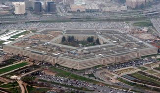 FILE - The Pentagon is seen in this aerial view in Washington, in this March 27, 2008 file photo. The Pentagon has revised its Law of War guidelines to remove wording that could permit U.S. military commanders to treat war correspondents as unprivileged belligerents if they think the journalists are sympathizing or cooperating with enemy forces. The amended manual, published on July 22, 2016, also drops wording that equated journalism with spying. (AP Photo/Charles Dharapak, File)