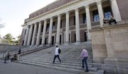 People gather in front of Widener Library on the campus of Harvard University in Cambridge, Mass. (Associated Press)