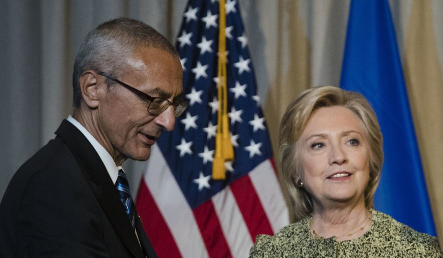 Clinton campaign chair John Podesta with Democratic presidential candidate Hillary Clinton in New York, Monday, Sept. 19, 2016. (AP Photo/Matt Rourke)