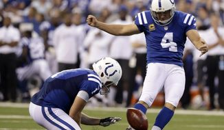 FILE - In this Sept. 25, 2016, file photo, Indianapolis Colts' Adam Vinatieri (4) kicks a 33-yard field goal out of the hold of Pat McAfee (1) during the first half of an NFL football game against the San Diego Chargers in Indianapolis. Around the Colts' locker room, they're giving Vinatieri the silent treatment. Nobody wants to talk about his streak. Nobody wants to jinx his pursuit of another NFL record. Nobody, of course, except the 43-year-old Vinatieri, who never frets about such streaks.  (AP Photo/Jeff Roberson, File)