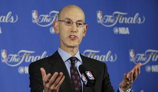 FILE - In this June 2, 2016, file photo, NBA commissioner Adam Silver speaks during a news conference before Game 1 of basketball's NBA Finals between the Golden State Warriors and the Cleveland Cavaliers in Oakland, Calif. Silver said Wednesday, Oct. 12, discussions will resume on the collective bargaining agreement next week after he returns from China, with two months left before a key deadline. (AP Photo/Jeff Chiu, File) **FILE**