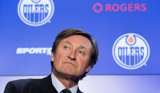 Wayne Gretzky attends a press conference announcing he will be re-joining the NHL hockey club in an off-ice role Wednesday Oct. 12, 2016, in Edmonton, Albera. (Amber Bracken/The Canadian Press via AP)