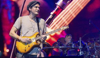 """FILE - In this June 12, 2016 file photo, John Mayer of Dead & Company performs at Bonnaroo Music and Arts Festival in Manchester, Tenn. Mayer won't be performing at a tribute concert honoring the late rock icon Prince on Thursday. Concert promoter Randy Levy told the Minneapolis Star Tribune late Tuesday, Oct. 11, that Mayer had a """"change of schedule"""" and had to withdraw from the concert at the Xcel Energy Center in St. Paul, Minnesota. (Photo by Amy Harris/Invision/AP, File)"""