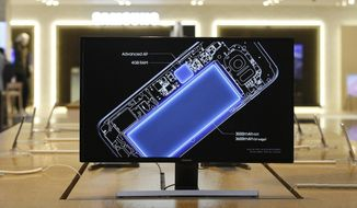 A screen shows an internal design drawings of Samsung Electronics Galaxy S7 smartphone at its shop in Seoul, South Korea, Wednesday, Oct. 12, 2016. The fiasco of Samsung's fire-prone Galaxy Note 7 smartphones - and Samsung's stumbling response to the problem - has left consumers from Shanghai to New York reconsidering how they feel about the South Korean tech giant and its products. (AP Photo/Ahn Young-joon)