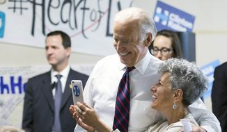 Vice president Joe Biden takes a photo with a supporter at a Democratic coordinated field office during an unscheduled stop at W. Sahara Avenue Thursday, Oct. 13, 2016, in Las Vegas. (Erik Verduzco/Las Vegas Review-Journal via AP)