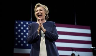 Democratic presidential candidate Hillary Clinton takes the stage at a fundraiser at the Civic Center Auditorium in San Francisco, Thursday, Oct. 13, 2016. (AP Photo/Andrew Harnik)