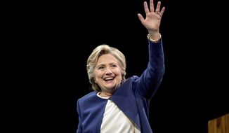 Democratic presidential candidate Hillary Clinton waves after speaking at a fundraiser at the Civic Center Auditorium in San Francisco, Thursday, Oct. 13, 2016. (AP Photo/Andrew Harnik)