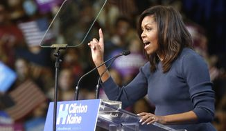 First lady Michelle Obama speaks during a campaign rally for Democratic presidential candidate Hillary Clinton Thursday, Oct. 13, 2016, in Manchester,NH (AP Photo/Jim Cole)