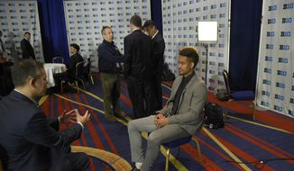 Maryland's Mel Trimble, right, gets interviewed during Big Ten NCAA college basketball media day, Thursday, Oct. 13, 2016, in Washington. (AP Photo/Nick Wass)