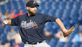 FILE - In this Sept. 4, 2016, file photo, Atlanta Braves relief pitcher Jim Johnson throws a pitch during the ninth inning of a baseball game against the Philadelphia Phillies, in Philadelphia. Jim Johnson is guaranteed $10 million under his new two-year contract with the Braves. The 33-year-old right-hander gets a $1 million signing bonus and salaries of $4.5 million in each of the next two seasons.  (AP Photo/Chris Szagola, File)