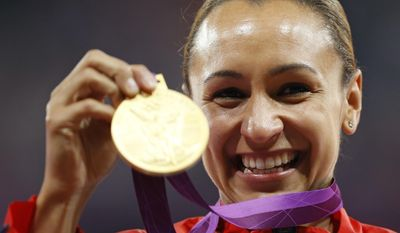 FILE - In this Aug. 4, 2012 file photo Britain's Jessica Ennis poses with her gold medal for the heptathlon during the athletics in the Olympic Stadium at the 2012 Summer Olympics, London. The 30-year-old Ennis-Hill has announced her retirement from track and field on Thursday, Oct. 13, 2016. (AP Photo/Daniel Ochoa De Olza, file)