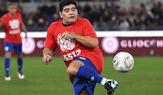 Argentinian soccer legend Diego Armando Maradona warms up prior to the 'United for Peace', charity soccer match at Rome' s Olympic stadium, Wednesday,  Oct. 12, 2016. (Alessandro Di Meo/ANSA via AP)