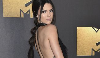 FILE - In this April 9, 2016 file photo, Kendall Jenner arrives at the MTV Movie Awards in Burbank, Calif. Jenner appeared in a downtown Los Angeles courtroom on Thursday, Oct. 13, 2016, to testify against a man charged with stalking the actress after he was arrested outside her Hollywood Hills home in August. (Photo by Jordan Strauss/Invision/AP, File)