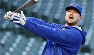 Chicago Cubs pitcher Jon Lester swings during a team workout in preparation for Saturday's Game 1 in baseball's National League Championship Series in Chicago, Thursday, Oct. 13, 2016. (AP Photo/Nam Y. Huh)