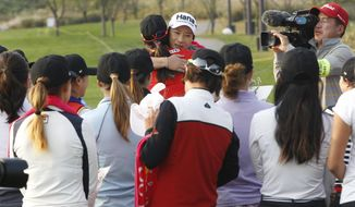 Se Ri Pak, center right, of South Korea is farewelled by her colleague golfers during her retirement ceremony at the LPGA KEB HanaBank Championship 2016 tournament at Sky72 Golf Club in Incheon, South Korea, Thursday, Oct. 13, 2016. (AP Photo/Ahn Young-joon)