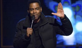 "FILE - In this Feb. 28, 2015 file photo, comedian Chris Rock performs at Comedy Central's ""Night of Too Many Stars: America Comes Together for Autism Programs"" in New York. Netflix says the comedian is filming two stand-up specials after an eight-year absence. The first show will tape in 2017, following a new world tour. (Photo by Charles Sykes/Invision/AP, File)"