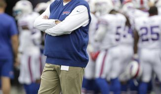 FILE - In this Oct. 2, 2016, file photo, Buffalo Bills head coach Rex Ryan stands on the field before an NFL football game against the New England Patriots, in Foxborough, Mass. It's a free country, so it makes no difference to Rex Ryan whether Colin Kaepernick continues to kneel in protest during the national anthem when Buffalo hosts the 49ers on Sunday. The Bills coach is more concerned what the San Francisco quarterback can do with his arm and legs once the game begins now that Kaepernick has reclaimed the starting job. (AP Photo/Steven Senne, File)
