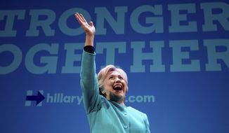 Democratic presidential candidate Hillary Clinton waves as she takes the stage to speak at a fundraiser at the Paramount Theatre in Seattle, Friday, Oct. 14, 2016. (AP Photo/Andrew Harnik) ** FILE **