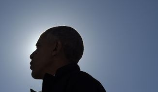 President Barack Obama speaks at a campaign rally for Democratic presidential candidate Hillary Clinton, Friday, Oct. 14, 2016, at the Cleveland Burke Lakefront Airport in Cleveland, Ohio. (AP Photo/Susan Walsh)