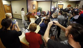 In this April 4, 2016, file photo, a large crowd of media and voting rights advocates listen as Arizona Secretary of State Michele Reagan speaks during a news conference after she certified the official canvass of the Arizona presidential primary election in Phoenix. New ID requirements. Unfamiliar or distant polling places. Names missing from the voter rolls. Those are just some of the challenges that could disrupt voting across the country through Election Day. While most elections have their share of glitches, experts worry conditions are ripe this year for trouble at the nations polling places. (AP Photo/Ross D. Franklin, File)
