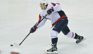 Washington Capitals defenseman John Carlson (74) shoots the puck during an NHL hockey game against the Pittsburgh Penguins Thursday, Oct. 13, 2016, in Pittsburgh, PA. (AP Photo/Fred Vuich)