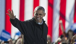 President Barack Obama walks on stage before delivering a speech to support  Democratic presidential candidate Hillary Clinton at Burke Lakefront Airport in Cleveland, Friday, Oct. 14, 2016. (AP Photo/Phil Long) ** FILE **