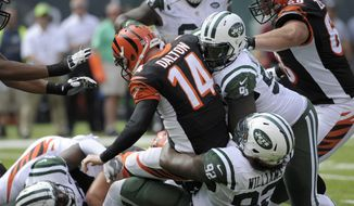 FILE - In this Sept. 11, 2016, file photo, Cincinnati Bengals quarterback Andy Dalton (14) is sacked by New York Jets' Leonard Williams (92) and Muhammad Wilkerson (96) during the first half of an NFL football game, in East Rutherford, N.J. The Bengals were one of the best teams at protecting the quarterback the last few years. During a 2-3 start, they've been among the worst, with Andy Dalton under constant pressure. (AP Photo/Bill Kostroun, File)