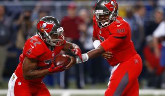 FILE - In this Dec. 17, 2015, file photo, Tampa Bay Buccaneers quarterback Jameis Winston, right, hands off to running back Doug Martin during the first quarter of an NFL football game against the St. Louis Rams in St. Louis. Winston has to play better for the Buccaneers to realize their potential and this weekend's bye offers an opportunity for several injured starters, including Martin. (AP Photo/Billy Hurst, File)