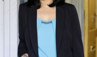 FILE--In this file photo taken April 20, 2016, state Sen. Pramila Jayapal, D-Seattle, poses for a photo in Seattle. Jayapal is one of two candidates seeking to replace U.S. Rep. Jim McDermott, retiring after 14 terms in Congress, in Washington's deeply liberal 7th Congressional District. (AP Photo/Elaine Thompson, file)