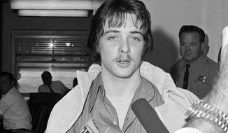 FILE - In this June 15, 1970 file photo, Robert Beausoleil leaves Los Angeles County Superior court. California officials have denied parole for the follower of cult leader Charles Manson who is serving a life prison term for a murder he committed 47 years ago. Parole officials announced Friday, Oct. 14, 2016, that Beausoleil will remain in prison for the 1969 death of musician Gary Hinman. (AP Photo/David F. Smith, File)