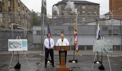 FILE - In this July 30, 2015 file photo, Maryland Gov. Larry Hogan, center, speaks alongside Maryland Secretary of Public Safety and Correctional Services Stephen Moyer at Baltimore City Detention Center, in Baltimore, to announce his plan to immediately shut down the jail. The jail grabbed headlines in 2013 after a sweeping federal indictment exposed a sophisticated drug- and cellphone-smuggling ring involving dozens of gang members and correctional officers. When Moyer took over Maryland's ailing prison system, coming aboard in January 2015 when Hogan took office, he had one goal: combat corruption. Moyer has overhauled the process for hiring new officers to make better hires, however, guards say the time required for bringing on staff is creating long vacancies and a dangerous work environment.  (AP Photo/Patrick Semansky, File)