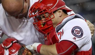 FILE - In this Sept. 26, 2016, file photo, Washington Nationals catcher Wilson Ramos goes down with a knee injury during the sixth inning of a baseball game against the Arizona Diamondbacks in Washington. Ramos had surgery Friday, Oct. 14, 2016, on his right knee and his rehabilitation is expected to take six-to-eight months. (AP Photo/Andrew Harnik, File)