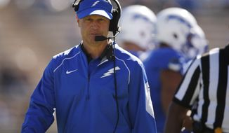 FILE - In this Oct. 24, 2015, file photo, Air Force coach Troy Calhoun walks along the sideline during the team's NCAA college football game against Fresno State at Air Force Academy, Colo. Air Force faces New Mexico on Saturday in Dallas. (AP Photo/David Zalubowski, File)