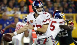 FILE - In this Oct. 9, 2016, file photo, New York Giants' Eli Manning throws during the first half of an NFL football game against the Green Bay Packers in Green Bay, Wis. Manning has not been sharp and the offensive line has been inconsistent. (AP Photo/Mike Roemer, File)