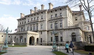 """FILE - In this Dec. 1, 2014, file photo, visitors walk toward an entrance to The Breakers mansion in Newport, R.I. Preservationists, architects and dozens of members of the Vanderbilt family have taken out an ad in a newspaper in hopes of quashing a plan to build a visitors center at The Breakers estate in Newport. The ad, which ran Thursday, Oct. 13, 2016, in Newport This Week, says the plan would """"desecrate The Breakers landscape"""" and """"permanently mar this national symbol of Newport's Gilded Age.""""   (AP Photo/Steven Senne, File)"""