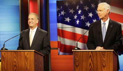 U.S. Sen. Ron Johnson, R, right, prepares for a debate Friday, Oct. 13, 2016, with Democratic challenger Russ Feingold, a former U.S. senator, at the studios of WLUK Fox 11 in Green Bay, Wisc. (Sarah Kloepping  /The Green Bay Press-Gazette via AP)