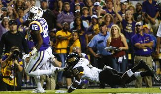 LSU wide receiver D.J. Chark (82) gets past Southern Mississippi defensive back Devonta Foster (15) for a touchdown during the first half of an NCAA college football game, Saturday, Oct. 15, 2016, in Baton Rouge, La. (AP Photo/Butch Dill)
