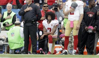 San Francisco 49ers quarterback Colin Kaepernick (7) kneels during the national anthem before an NFL football game against the Buffalo Bills on Sunday, Oct. 16, 2016, in Orchard Park, N.Y. (AP Photo/Mike Groll)