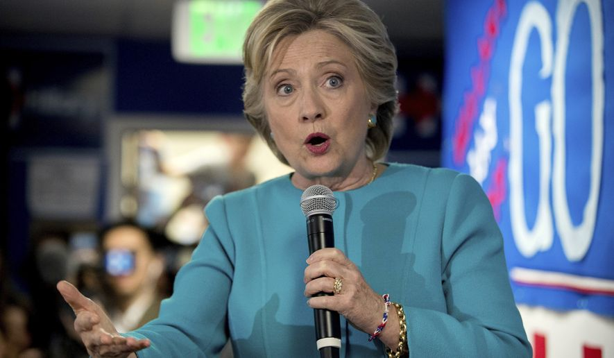 FILE - In this Oct. 14, 2016 file photo, Democratic presidential candidate Hillary Clinton speaks to volunteers at a campaign office in Seattle. Hillary Clinton has a tight grip on the Electoral College majority need to be elected president of the U.S., and may very well be on her way to a big victory, and that's how some Republicans see it.  (AP Photo/Andrew Harnik, File)