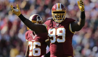 Washington Redskins defensive end Ricky Jean Francois (99) gestures to fans in the second half of an NFL football game against the Philadelphia Eagles, Sunday, Oct. 16, 2016, in Landover, Md. (AP Photo/Mark Tenally)