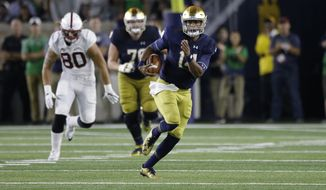 Notre Dame quarterback DeShone Kizer (14) runs against Stanford during the second quarter of an NCAA college football game in South Bend, Ind., Saturday, Oct. 15, 2016. (AP Photo/Michael Conroy)