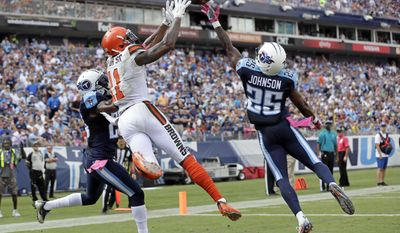 Cleveland Browns wide receiver Terrelle Pryor (11) catches a 7-yard touchdown pass as he is defended by Tennessee Titans cornerback Brice McCain (23) safety Rashad Johnson (25) in the first half of an NFL football game Sunday, Oct. 16, 2016, in Nashville, Tenn. (AP Photo/James Kenney)