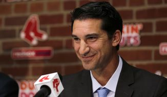 FILE - In this Sept. 24, 2015, file photo, Boston Red Sox newly appointed general manager Mike Hazen smiles at Fenway Park in Boston. The Arizona Diamondbacks have named Hazen as executive vice president and general manager. The team announced the hiring in a news release on Sunday, Oct. 16, 2016. (AP Photo/Charles Krupa, File)