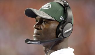 FILE - In this Aug. 19, 2016, file photo, New York Jets head coach Todd Bowles stands on the sidelines during the second half of an NFL preseason football game against the Washington Redskins in Landover, Md. The Jets taken on the Arizona Cardinals on Monday night in Arizona. (AP Photo/Mark Tenally, File)