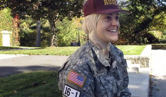 """In this Oct. 12, 2016 photo, freshman student Sana Hamze speaks in Northfield, Vt., about her time as a """"rook,"""" or first year student in the military college's Corps of Cadets. Norwich University has allowed Hamze to wear her Muslim headscarf as part of her Norwich uniform. Hamze chose Norwich after another military school refused to change its uniform code to accommodate her request. (AP Photo/Wilson Ring)"""